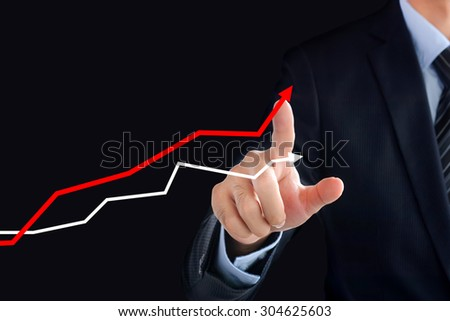 Businessman hand touching rising graph on virtual screen - business, financial and investment success concepts