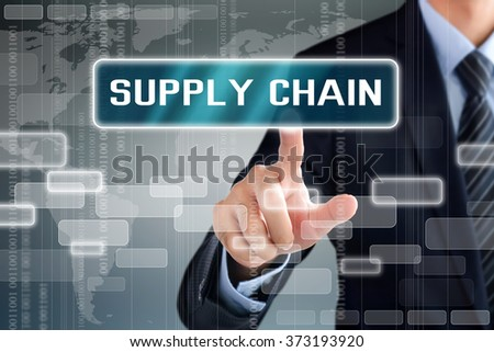 Businessman hand touching SUPPLY CHAIN sign on virtual screen - stock photo