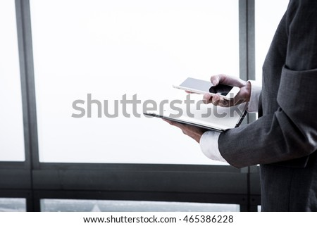 businessman hand touching the screen of a smartphone.
