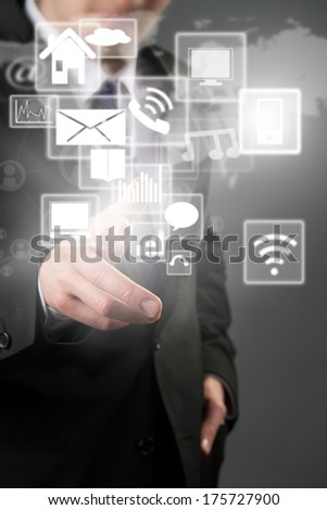 Businessman hand touching virtual scheme with icons