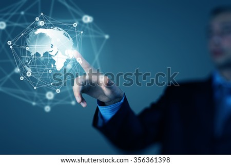 Businessman hand touching with finger digital connection lines on virtual screen - stock photo