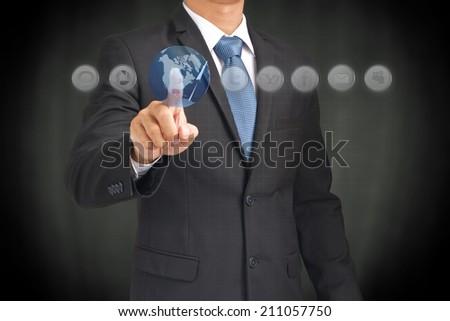 Businessman hand touching world map - stock photo