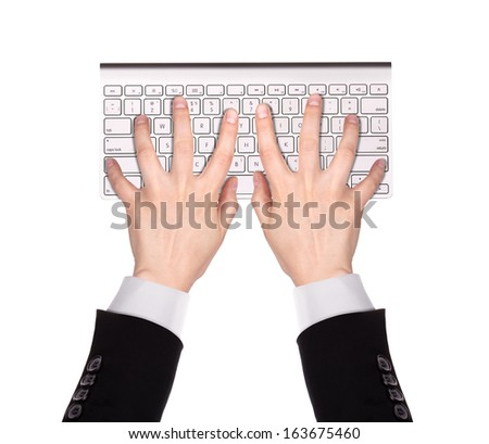 Businessman Hand typing on the remote wireless computer keyboard in an office at a workplace isolated on a white background - stock photo