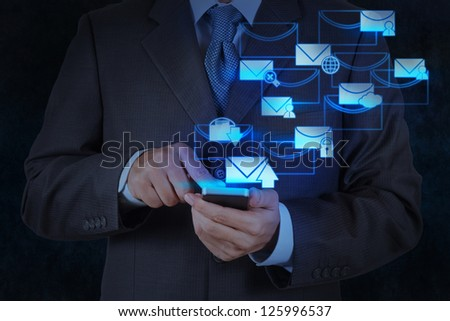 businessman hand use smart phone computer with modern email icon