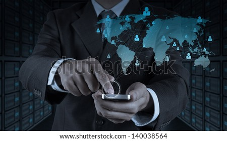 businessman hand use smart phone computer with social network as concept - stock photo
