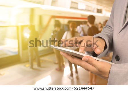 Businessman Hand use Wireless Tablet PC Device in Railway Station or Train Station