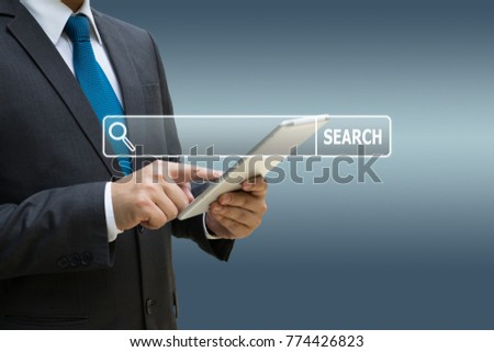 Businessman hand using digital tablet for searching information on internet