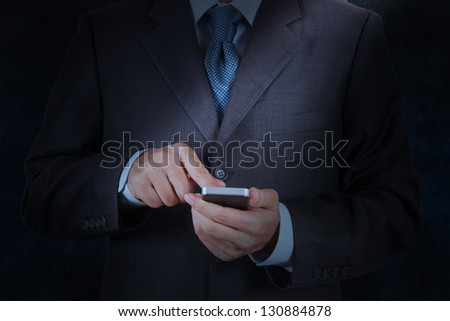businessman hand using mobile smart phone