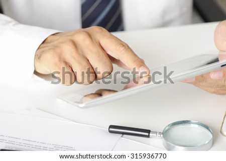 businessman hand using tablet