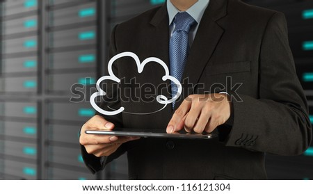 businessman hand using tablet computer and  a cloud network concept - stock photo