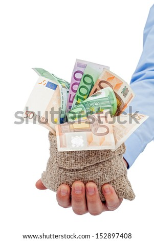Businessman hand with a bag full of euro banknotes - isolated - stock photo