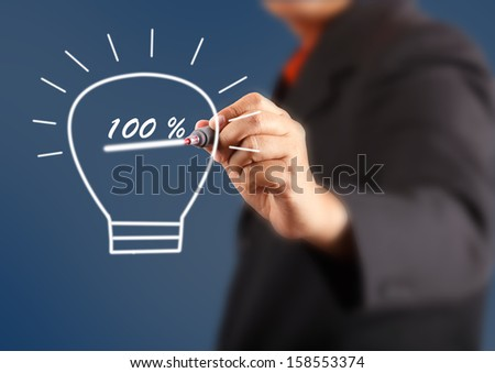 businessman hand with a pen drawing light bulb inside ispercent - stock photo