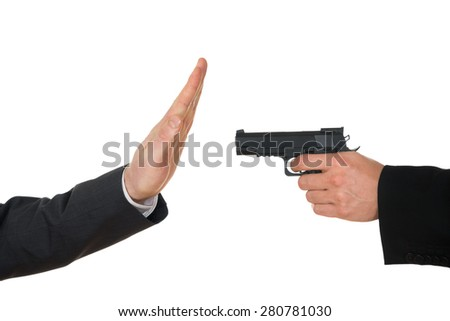 Businessman Hand With Gun Pointing Towards Businessperson Gesturing Stop Sign Over White Background