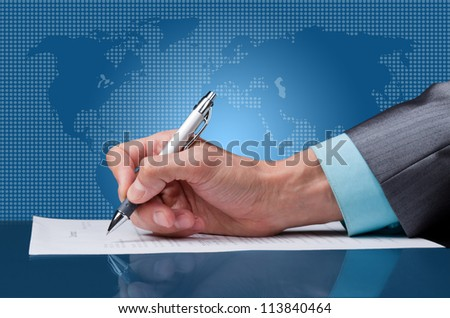businessman hand with pen sign up contract document on desk over blue digital world map  background concept of global business - stock photo