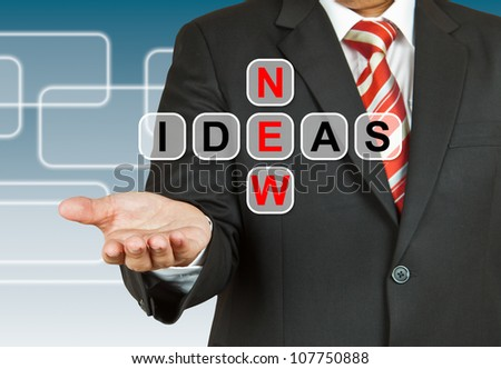 Businessman hand with text New Ideas
