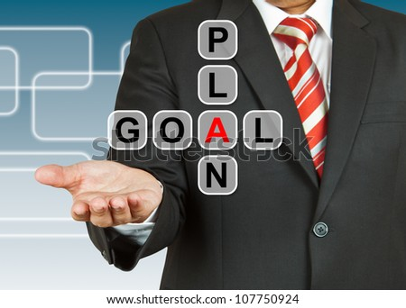 Businessman hand with text Plan and Goal - stock photo