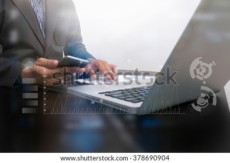 businessman hand working smart phone and laptop on wooden desk in office with Double exposure, digital layer effect, Silhouette shot,soft focus - stock photo