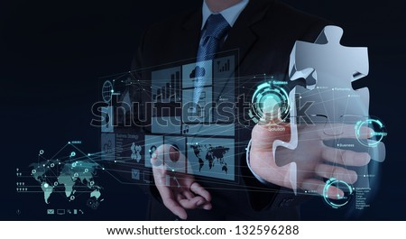 businessman hand working with computer interface show puzzles as partnership concept - stock photo