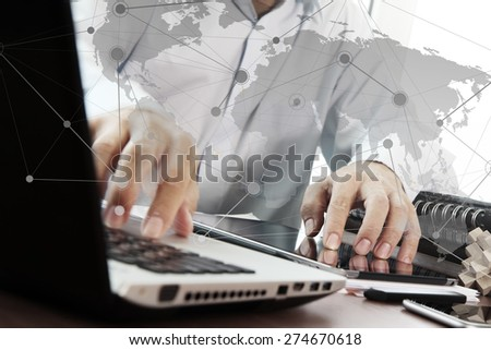 businessman hand working with digital tablet and laptop and social network media diagram on wooden desk in office - stock photo