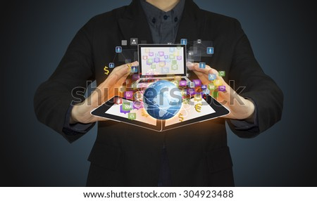 businessman hand working with modern computer and business Icon on technology. - stock photo
