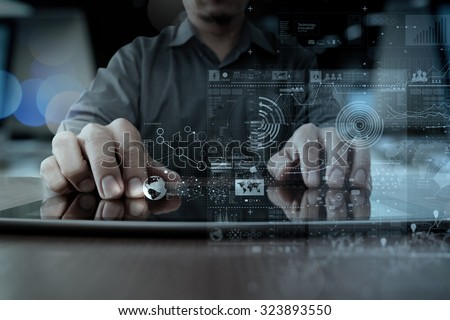 businessman hand working with modern technology digital tablet computer and graphics layer effect as business strategy concept - stock photo