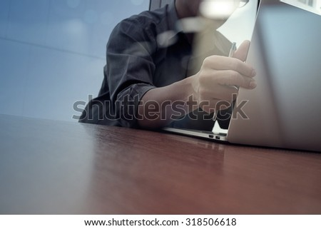 businessman hand working with new modern computer and smart phone and business strategy on wooden desk as concept - stock photo