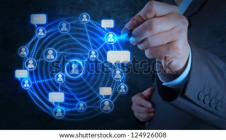 businessman hand working with new modern computer show social network structure - stock photo
