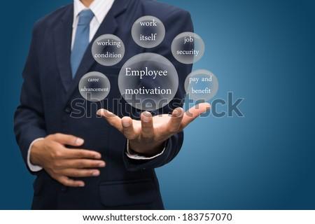 businessman hand write a employee motivation  - stock photo