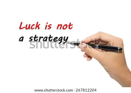 Businessman hand write a Luck is not a strategy - stock photo