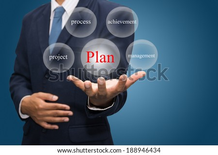 businessman hand write a plan - stock photo