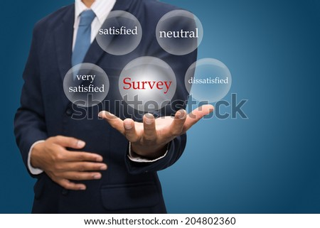 businessman hand write a Survey  - stock photo