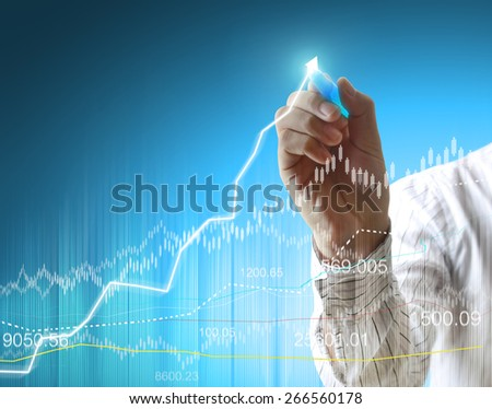 businessman hand writing a business graph  - stock photo