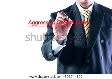 Businessman hand writing Aggressive Growth Fund on a transparent wipe board.