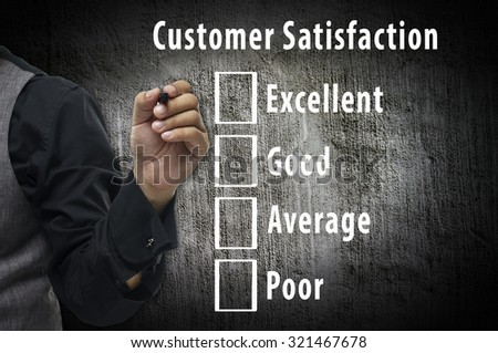 Businessman hand writing and Customer satisfaction survey checkbox - stock photo
