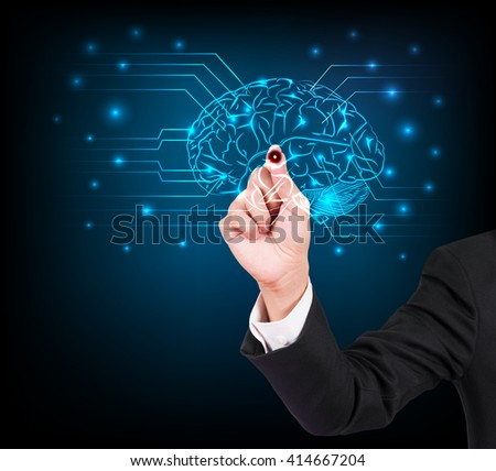 Businessman hand writing and drawing brain on a touch screen interface - stock photo