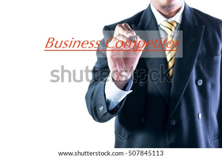 Businessman hand writing Business Competitor on transparent wipe board.