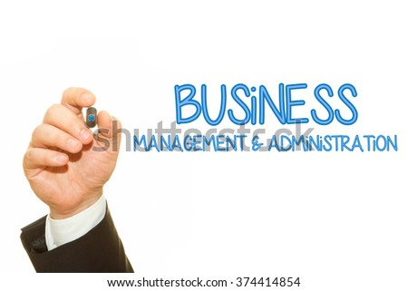 Businessman hand writing Business Management and Administration on a transparent wipe board