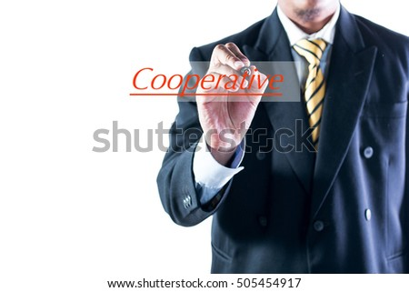Businessman hand writing Cooperative on transparent wipe board.