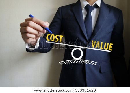 businessman hand writing Cost vs value concept  , business idea , business concept - stock photo