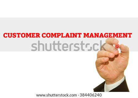 Businessman hand writing Customer Complaint Management isolated on white.