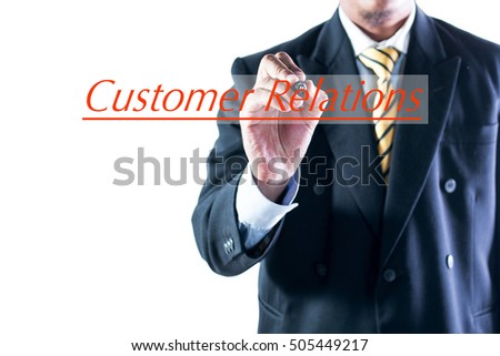 Businessman hand writing Customer Relations on transparent wipe board.