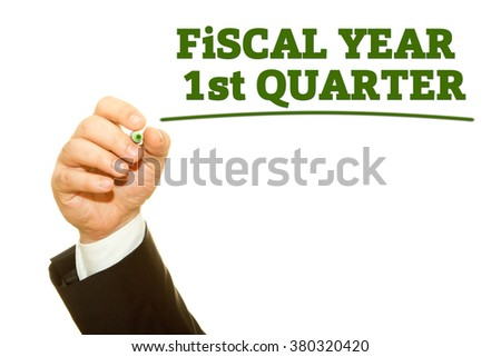 Businessman Hand writing Fiscal Year First Quarter on a transparent wipe board. Fiscal Year Concept.