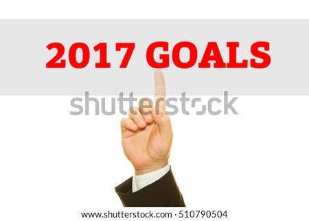Businessman hand writing 2017 Goals on a transparent wipe board