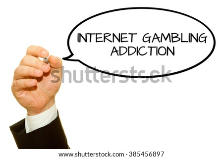Businessman hand writing Internet Gambling Addiction isolated on white.