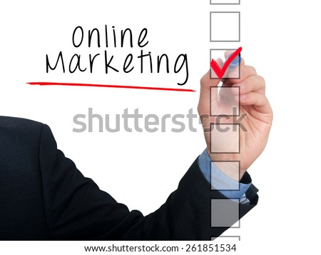 Businessman hand writing online marketing and check listing task. Isolated on white background. Stock photo