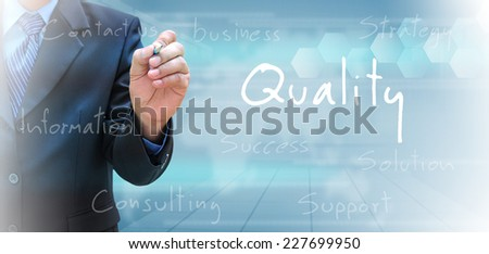 businessman hand writing quality  - stock photo