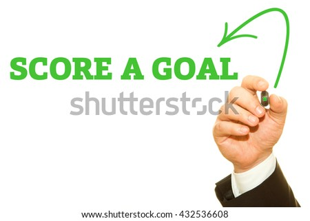Businessman hand writing SCORE A GOAL message on a transparent wipe board.