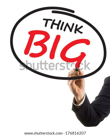 businessman hand writing text think big