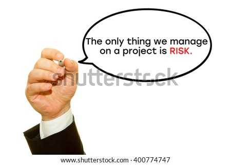 "Businessman hand writing ""The only thing we manage on a project is RISK."" on a transparent wipe board."