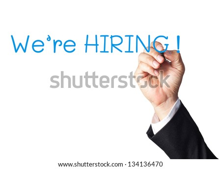 businessman hand writing we're hiring on white board - stock photo